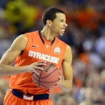 Syracuse Orange guard Michael Carter-Williams (1) reacts in the first half of the semifinals during the 2013 NCAA mens Final Four against the Michigan Wolverines at the Georgia Dome. Mandatory Credit: Bob Donnan-USA TODAY Sports