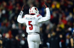 Louisville Cardinals quarterback Teddy Bridgewater (5) reacts to a touchdown during the fourth quarter against the Cincinnati Bearcats at Nippert Stadium. Mandatory Credit: Andrew Weber-USA TODAY Sports