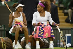 London, ENG - July 7, 2012: (L to R) Venus and Serena Williams in action during their women's doubles final round match during the 126th staging of the Wimbledon Championships at the All England Lawn Tennis and Croquet Club in Wimbledon (Photo by Allen Kee / ESPN Images).