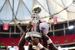 Atlanta, GA - December 19, 2015 - Georgia Dome: The North Carolina A&T State University Aggies holding up the trophy after winning the 2015 Air Force Reserve Celebration Bowl (Photo by Phil Ellsworth / ESPN Images)