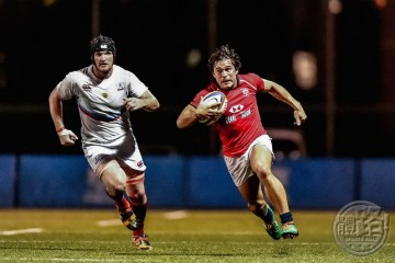 HKG winger Rowan Varty races in for his side's only try of the match