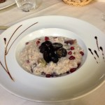 Risotto with pecorino, grapes, and walnuts