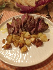 Sliced beef with roasted potatoes