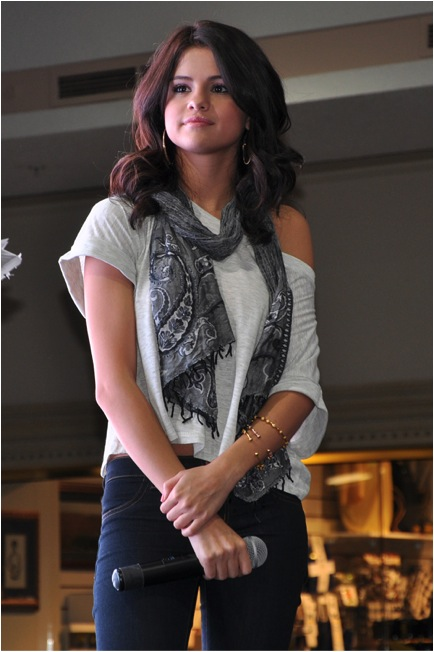 Selena Gomez wears her count me healthy bracelets and bangles