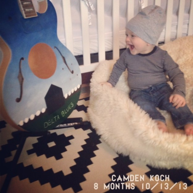 Camden modeling an H&M onesie with baby denim and an H&M beanie