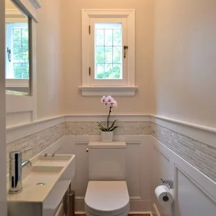 75 Popular Powder Room Design Ideas   Stylish Powder Room Remodeling     Example of a small classic gray tile and matchstick tile medium tone wood  floor powder room