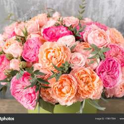 Beautiful Bouquet of Mixed Flowers in a Box on Wooden Table The