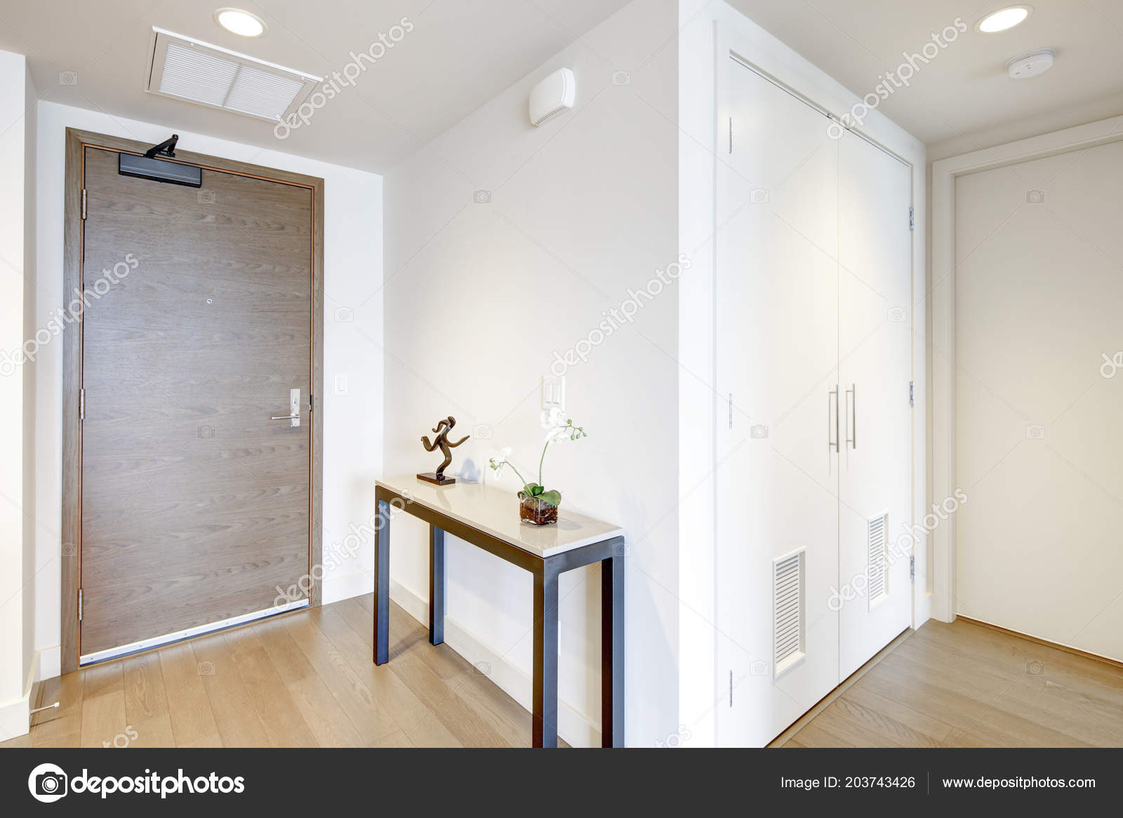 White Condo Entrance Hall Features Console Table Atop Light Brown U2014 Stock Photo