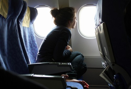 Girl-Looking-Out-of-Window