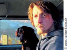 Porträt von Oliver Lück mit Hund