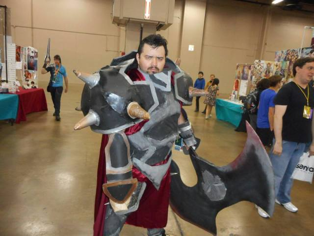 Darius is a general from Noxus. His sworn enemy is Demacia. He carries a big bloody axe and has no known weaknesses. He was last seen slashing prices in the Dealers Room at the Henry B. Gonzalez Convention Center.
