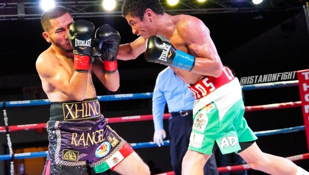 Carlos Carlson lands a right hand in his KO win over Alex Rangel | Photo Art Gallegos Jr./Standnfight.com