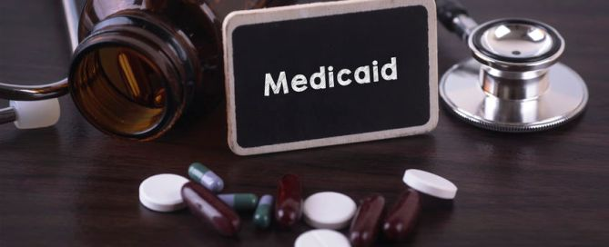Medicaid sign with pills an stethoscope