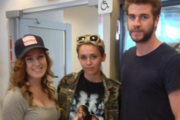 Miley Cyrus, Liam Hemsworth & Fan
