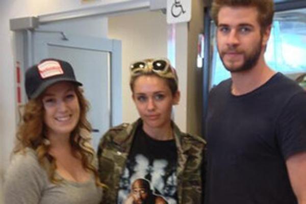 Miley Cyrus, Liam Hemsworth & Fan
