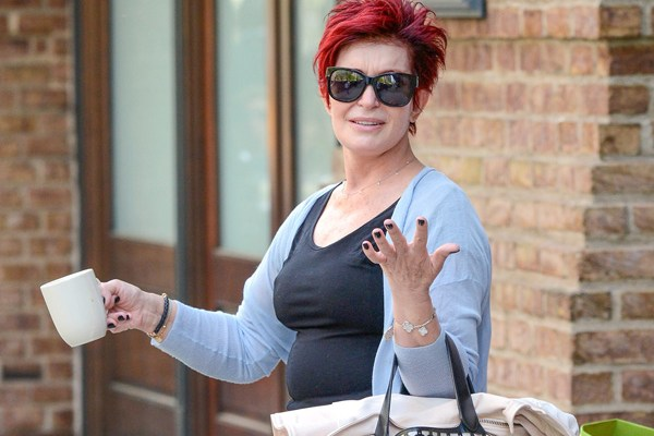 ***MANDATORY BYLINE TO READ INFPhoto.com ONLY*** Sharon Osbourne is seen leaving her hotel in New York City this morning, blowing kisses at the camera while holding a cup of coffee. She is also seen carrying