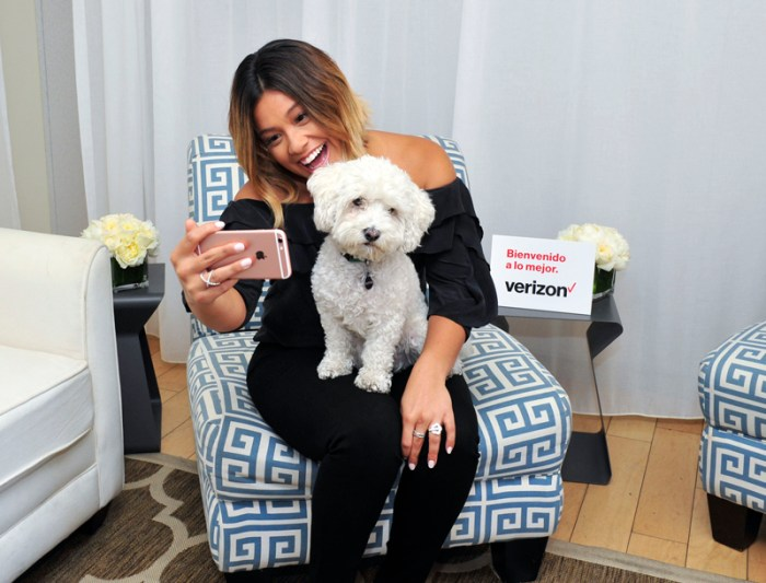 Gina Rodriguez Snaps a Selfie With Her Favorite Fan, Casper, During The Launch of Verizon`s Beinvenido a lo Mejor Contest