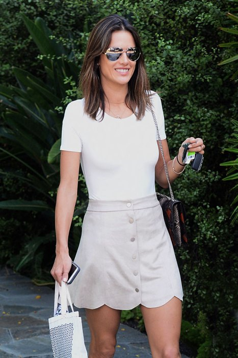 Alessandra Ambrosio looks youtful in tan mini skirt while shopping at Isabel Marant