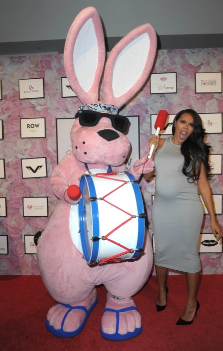 Angela Simmons poses with the Energizer Bunny during her fashion show at New York Fashion Week