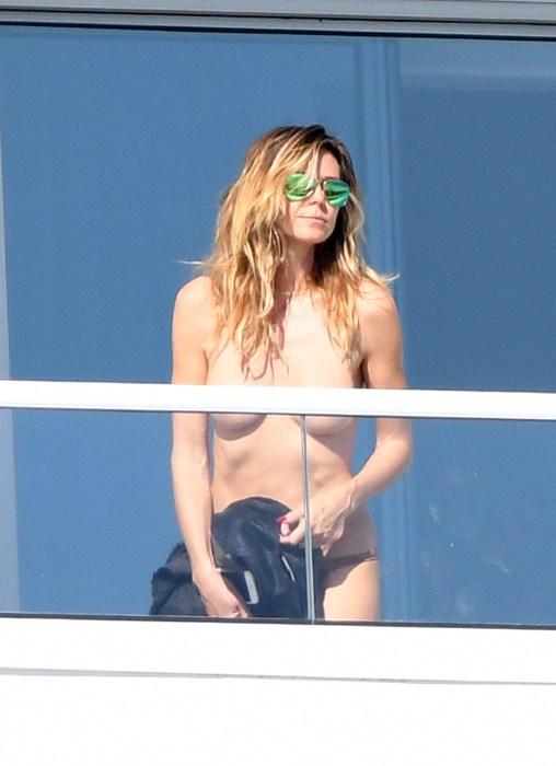 Supermodel Heidi Klum sunbathes topless on her balconyinMiami
