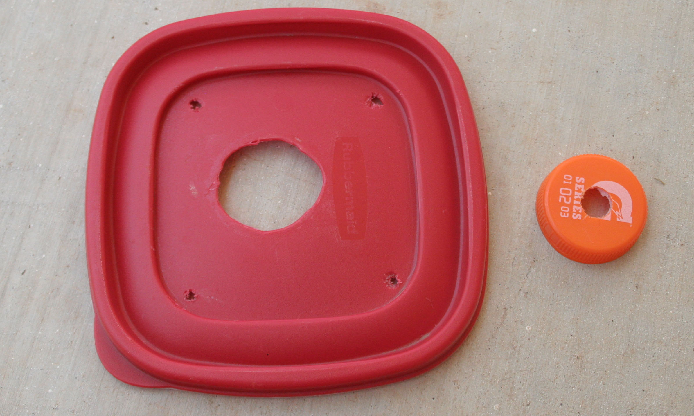 one of the trickier holes to cut is in the top of the powerade bottle the hole needs to be big enough so that the hummingbird food fills the tupperware - Homemade Hummingbird Food