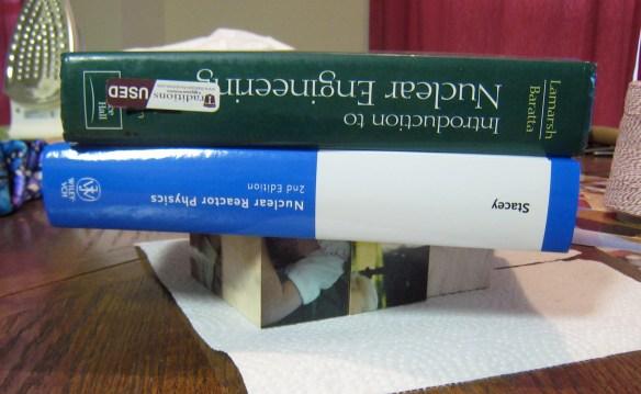 Photo blocks drying under books