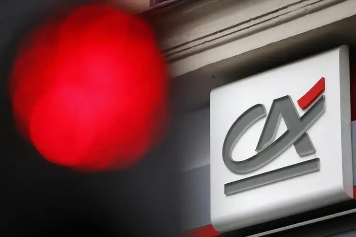 Credit Agricole confirms regional bank plan to boost capital     A traffic light shines red near a Credit Agricole logo  pictured on a bank  branch