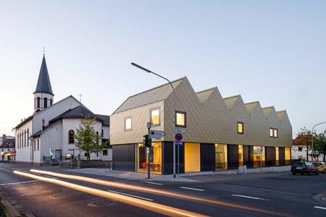 netzwerkarchitekten completes German community centre with metal-clad zigzagging roof