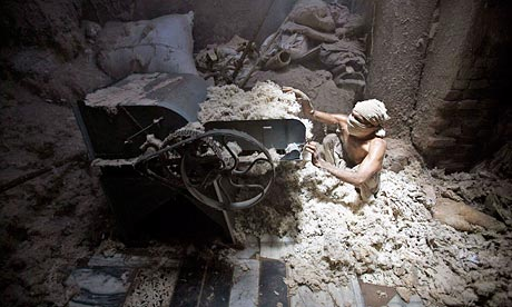 A man works in a cotton factoryc in Mumbai