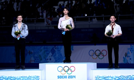 Patrick Chan of Canada poses after winning the silver, Yuzuru Hanyu of Japan after winning the gold and Denis Ten of Kazakhstan after winning the bronze in the men's figure skating.