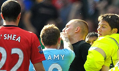 Craig Bellamy gers into an altercation with a Manchester United fan after yesterday's derby