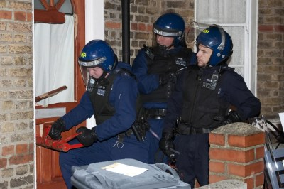 Four hundred police smash 'Brixton gang' in dawn raids and ...