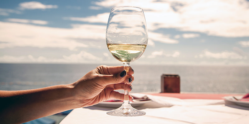 Image result for man holding a wine glass