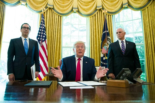 President Donald Trump with Steven Mnuchin and Mike Pence at the White House.