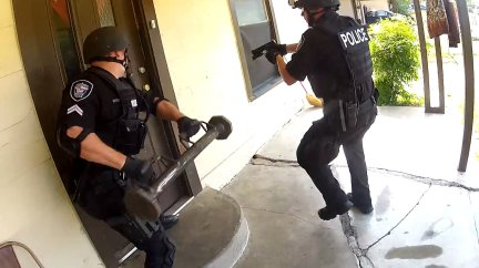 Image result for MAN CATCHES COPS ON VIDEO FRAMING HIM TO JUSTIFY BLOWING UP HIS DOOR AND RAIDING HOME