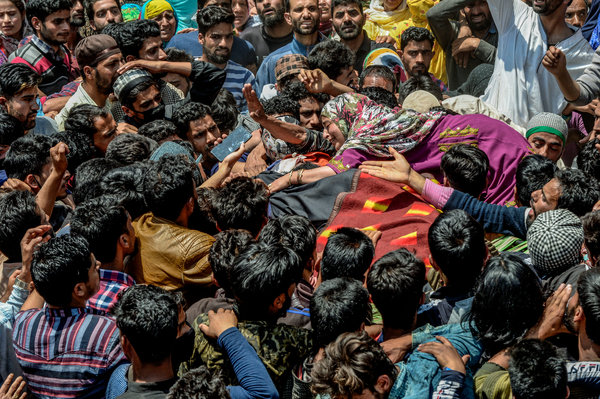 The wife of a militant during his funeral procession in Kulgam, South Kashmir, last month.