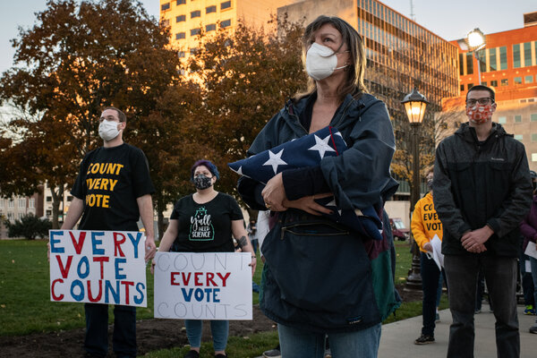 Michiganders attended a pro-vote-counting rally at the state capital in Lansing, Mich., Wednesday.