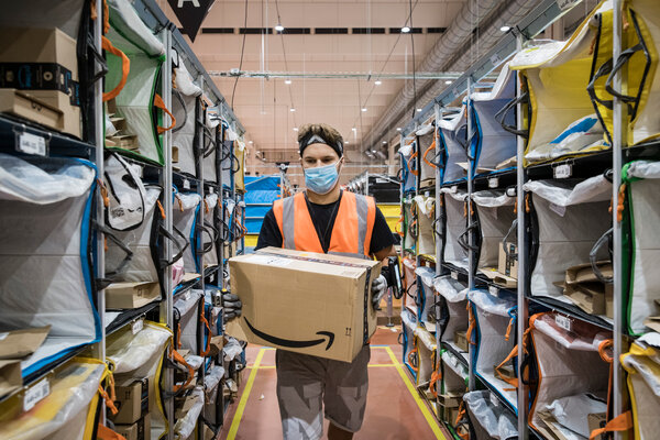 An employee at an Amazon facility in Naples, Italy in September. The online retailer has seen a massive increase in earnings during the pandemic.