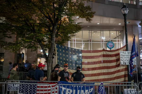 "Supporters of President Trump gathered outside the Pennsylvania Convention Center in Philadelphia. The law firm Porter Wright said the Trump campaign would be ""best served"" if the firm withdrew from the case."