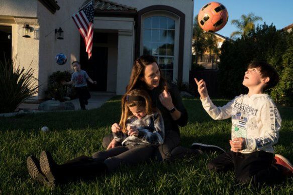Lt. Col.Nichelle Somers with her three children Jett, Lilah and Corbin outside their home in Riverside, Calif.