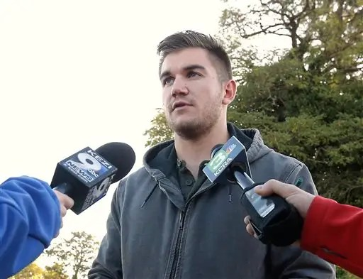 FILE - In this Friday, Oct. 2, 2015 file photo, Alek Skarlatos, one of the three Americans who stopped a terrorist attack aboard a Paris-bound train in August, talks to reporters about the shooting at Umpqua Community College, in Roseburg, Ore. Skarlatos is back on TVs