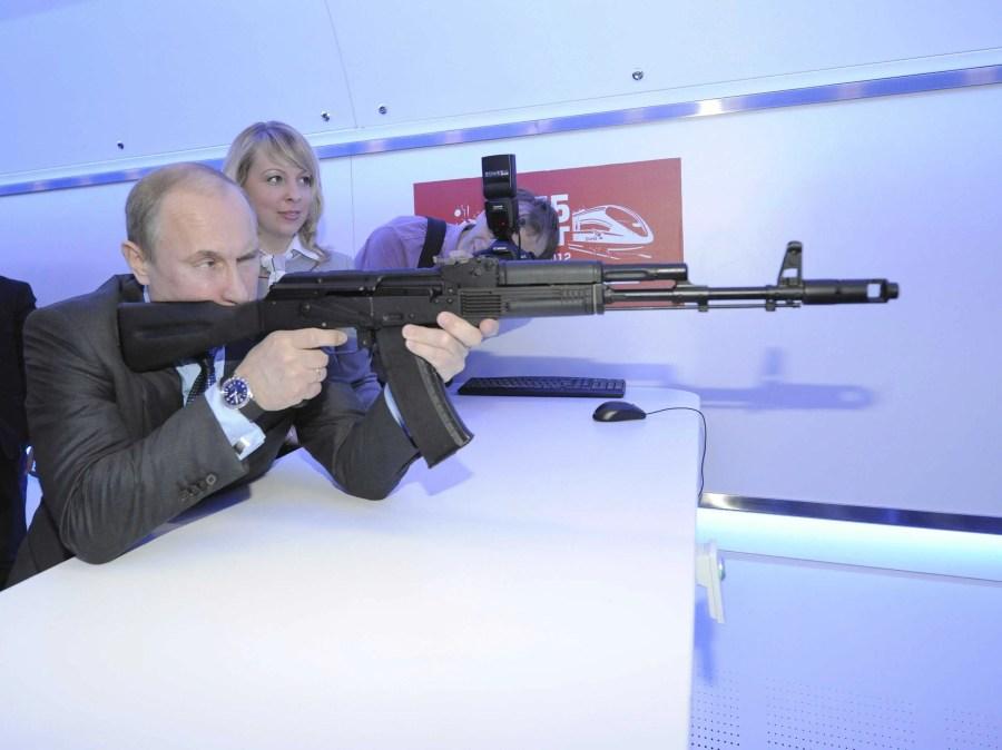 Here, Putin trains with an assault rifle simulator.