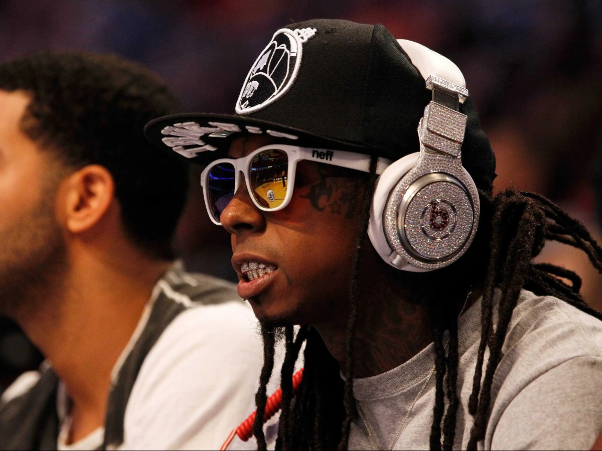 Rapper Lil Wayne sat courtside with his own custom Beats headphones, which appear to be the same pair that LMFAO infamously wore during their 2012 Super Bowl performance. Customized with 114 carats of diamonds by Graff Diamonds, they're valued at $1 million.