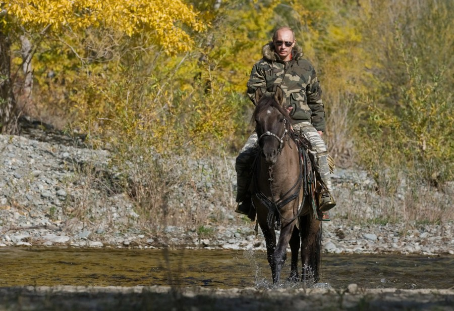 Here he rides a horse through a river in the Tyva Republic in the Siberian Federal District.
