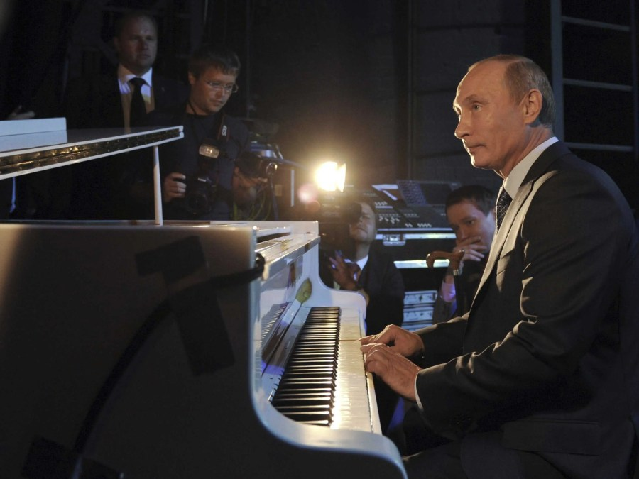 """Still, there's a lot more to Putin than shooting animals with tranquilizer guns while shirtless. Putin tickles the ivories for a crowd at the Theatre of Nations in Moscow. He often plays the patriotic song """"From What The Motherland Begins?"""" and the """"Anthem of Saint Petersburg,"""" his hometown jam."""