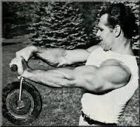 Bodybuilder performing forearm roller