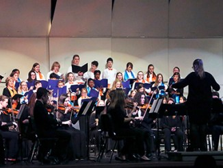 Student Intern, Renee Perry, leads the Stillwater Honor Choir in concert with the Oklahoma Youth Orchestra Philharmonic in March 500