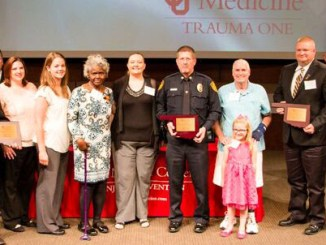 The Stillwater Police Department , Stillwater Fire Department and Stillwater Emergency Management accepted the Outstanding First Response Award at OU Medical Center's seventh annual Trauma Survivors Reception Friday, April 29. The City's public safety departments were recognized for their service and assistance to patients in response to the Oct. 24, 2015, parade tragedy.  Pictured left to right:  SFD Training Officer Jory Stanley, SFD Assistant Chief Robert Black, SFD Chief Tom Bradley, SPD Dispatcher Jacque Black, SPD Officer Stephanie Wheeler, Mary Turner, SPD Dispatcher Jennifer Kline, SPD Captain Kyle Gibbs, Hadley Wyatt, Leo Schmitz, SEMA Director Rob Hill, SPD Officer Kevin Radley, SPD Dispatcher Lisa Murrell and an OU Medicine staff member.