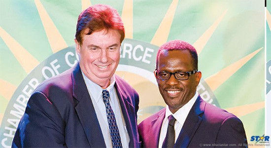 """Fellow Saint Lucians George Benson (l) and Philip J. Pierre: How does the minister determine between  good white guys and poster boys for the """"economic class""""?"""