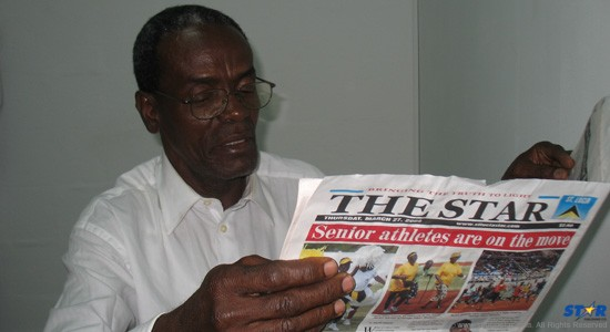 Elijah Greenidge in better times, having a read of an issue of The STAR.